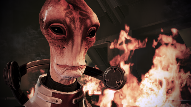 Mordin Solus the Salarian stands before an explosion in Mass Effect 3