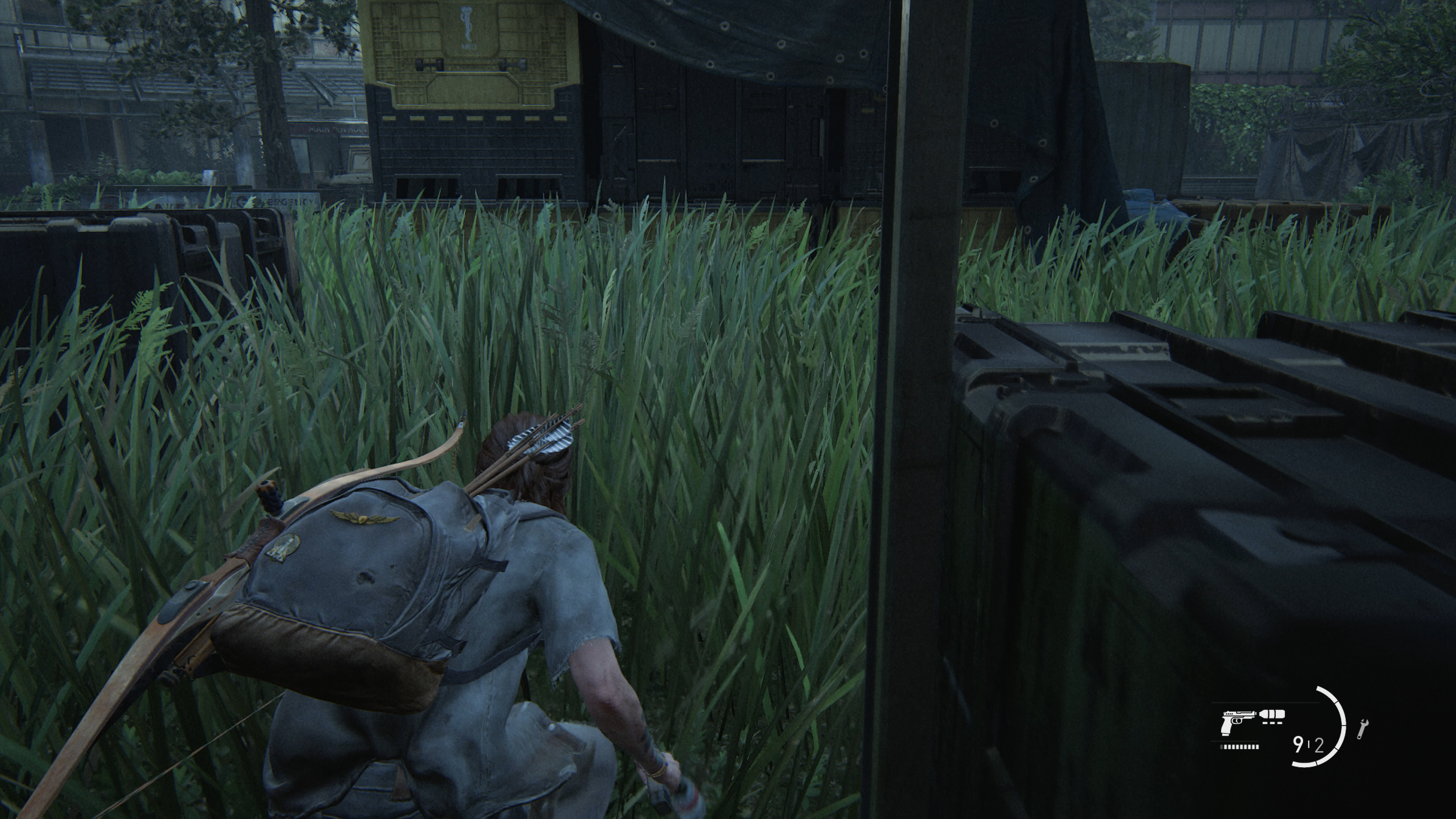 Ellie stealth in the grass from The Last of Us Part II